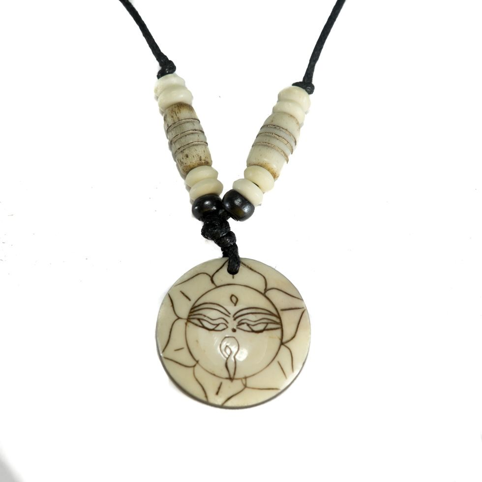 Bone pendant Buddha's eyes in lotus flower