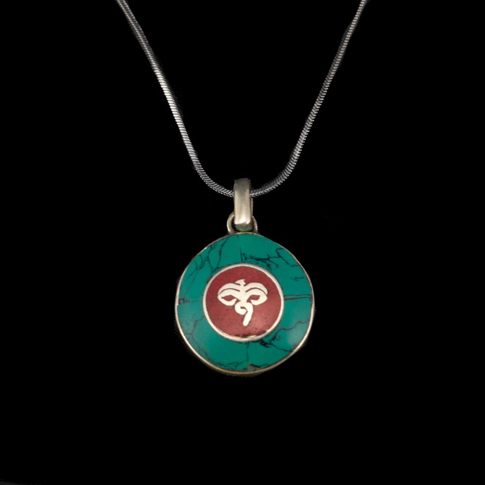 German silver pendant Buddha's eyes - in a circle