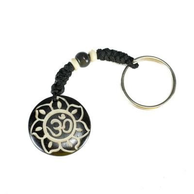 Key chain Om di bunga teratai hitam