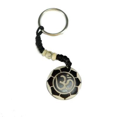 Key chain Om di bunga teratai putih